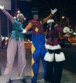 The world's tallest elf joins a toy soldier and a leggy Mrs. Claus at the Vineland Christmas Parade